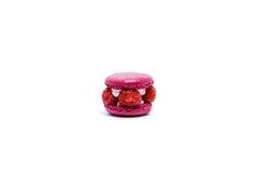 Raspberry macaron on white. Delicious raspberry macaron on white Stock Photo