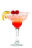 Raspberry margarita. Refreshing raspberry margarita on a white background garnished with a lime and an orange twist royalty free stock images