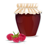 Raspberry marmalade in a jar and fresh raspberries Royalty Free Stock Images