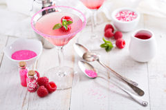 Raspberry martini on white table Stock Images