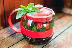 Raspberry mint tea in  teapot Royalty Free Stock Photos