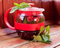Raspberry mint tea in  teapot Stock Image