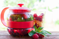 Raspberry mint tea in  teapot Royalty Free Stock Photography