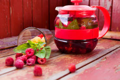 Raspberry mint tea in  teapot Royalty Free Stock Photo