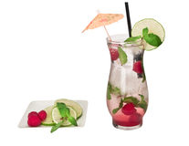 Raspberry Mojito. Isolated drink over white with mint, raspberries  and lime garnishes Stock Image