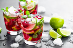 Raspberry mojito cocktail with lime, mint and ice, cold, iced refreshing drink Stock Photography