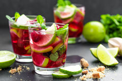 Raspberry mojito cocktail with lime, mint and ice, cold, iced refreshing drink. Or beverage Royalty Free Stock Images