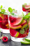 Raspberry mojito cocktail with lime, mint and ice, cold, iced refreshing drink. Or beverage Stock Image