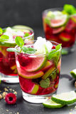 Raspberry mojito cocktail with lime, mint and ice, cold, iced refreshing drink. Or beverage Royalty Free Stock Image