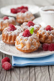 Raspberry muffins. Homemade muffins with a fresh raspberries on dark wooden background, selective focus Stock Photos