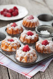 Raspberry muffins. Homemade muffins with a fresh raspberries on dark wooden background, selective focus Stock Image