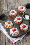 Raspberry muffins. Homemade muffins with a fresh raspberries on dark wooden background, selective focus Royalty Free Stock Photography