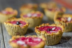 Raspberry muffins. On an old wooden table Stock Photos