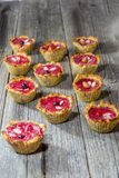 Raspberry muffins. On an old wooden table Royalty Free Stock Photography