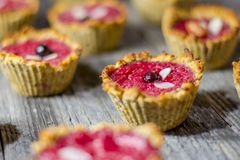 Raspberry muffins. On an old wooden table Royalty Free Stock Images