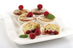 Raspberry muffins on plate, close-up Royalty Free Stock Photo