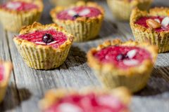 Raspberry muffins. On an old wooden table Stock Image