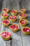 Raspberry muffins. On an old wooden table Royalty Free Stock Photo