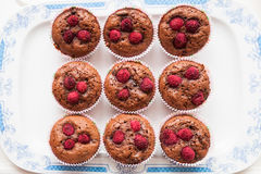 Raspberry muffins. Top view of homemade muffin with a fresh raspberries on porcelain plate Stock Photography