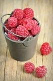 Raspberry on old wood Stock Photos