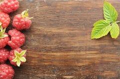 Raspberry on old wooden plank Stock Photos
