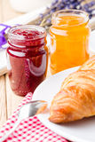Raspberry and orange jam with croissant. Royalty Free Stock Photos