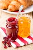 Raspberry and orange jam with croissant. Stock Photo
