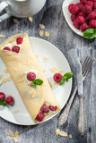Raspberry pancakes with almonds and icing sugar Stock Photos