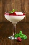 Raspberry panna cotta with fresh berries Stock Photography