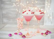 Panna cotta with popcorn. Raspberry panna cotta with a white mousse au chocolat and pink popcorn stock photo