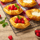Raspberry pastries Stock Photos