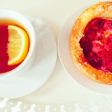 Raspberry pastry and cup of tea Stock Photo