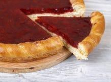 Raspberry pie closeup. Fresh raspberry pie, tasty filling, a piece of the pie Stock Photo