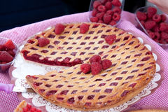 Raspberry pie. Freshly cooked pie with fresh raspberry on the table Royalty Free Stock Photo