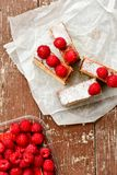 Raspberry pie. Healthy eating, food, dieting - pie  with  fresh raspberry soft cheese and  icing sugar, on    wooden background Royalty Free Stock Photography