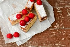 Raspberry pie. Healthy eating, food, dieting - pie  with  fresh raspberry soft cheese and  icing sugar, on    wooden background Stock Photo