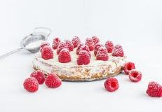 Raspberry pie on a white background. Raspberry pie with cream on a white wooden background stock photo