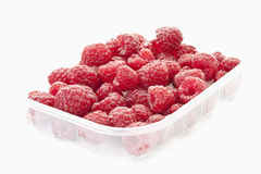 Raspberry in plastic container Royalty Free Stock Images