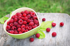 Raspberry in plate in the form of heart Stock Photography