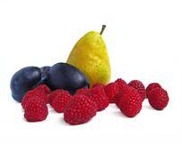 Raspberry, plum and pear. Isolated on white background Stock Images