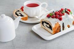 Raspberry poppy cake for holidays. With tea Stock Photos
