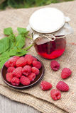 Raspberry preserve and fresh raspberries Royalty Free Stock Images