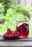 Raspberry preserve in glass jar and fresh raspberries Royalty Free Stock Photo