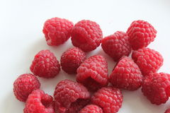 Raspberry. Red raspberries scattered on white plate Stock Images