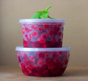 Raspberry in the round box with leaf of mint Royalty Free Stock Photography