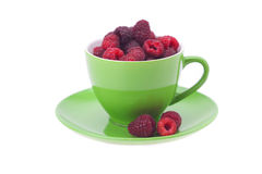 Raspberry, saucer and cup  isolated on a white Royalty Free Stock Photo