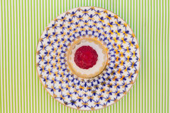 Raspberry on a saucer on  white-green background Royalty Free Stock Image