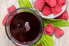 Raspberry Sirup in a glass. (with fresh fruits Stock Photography