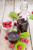 Raspberry Sirup in a glass. (with fresh fruits Stock Images