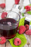 Raspberry Sirup in a glass Stock Photography